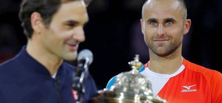 Copil s-a înclinat în faţa lui Federer